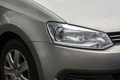 Vehicle with Rain Droplets on Wheel Tyre and Bonnet Royalty Free Stock Photography