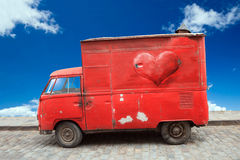 Vehicle with red shaped heart, love concept. Stock Image