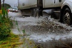 Vehicle ignoring road because of flooding car drives through flooded road. Vehicle road because of flooding car drives through flooded road royalty free stock photos
