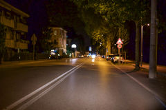 Vehicle on Road Near Lighted Street Light during Nighttime Royalty Free Stock Image