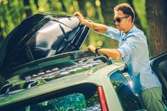 Vehicle Roof Cargo Installation Royalty Free Stock Photography