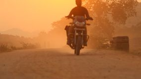 Vehicle on rural village road stock video footage