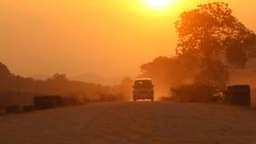 Vehicle on rural village road stock video