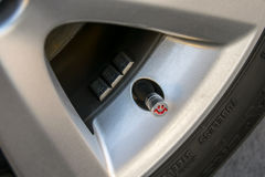 Vehicle safe and happy concept. Checking tire pressure. Pumping air into auto wheel Royalty Free Stock Image