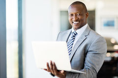 Vehicle sales consultant laptop Royalty Free Stock Photo