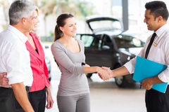 Vehicle salesman handshake customer Royalty Free Stock Photo