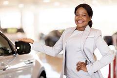 Vehicle saleswoman presenting cars Royalty Free Stock Image