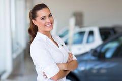Vehicle saleswoman showroom Royalty Free Stock Photos