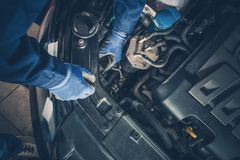 Vehicle Seasonal Maintenance. Authorized Car Service Worker Performing Auto Service. Checking on Headlight Bulbs royalty free stock images