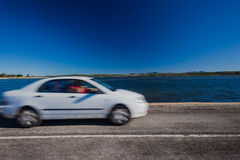 Vehicle Speed Blur Lagoon Road Stock Image