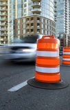 Vehicle speeds past a large, orange traffic cone Stock Images
