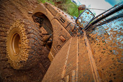 Vehicle splattered in mud Stock Image
