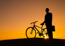 Vehicle sun businessman bike sunlight Stock Photography