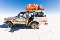 Vehicle SUV Salar De Uyuni desert plateau drive journey. Royalty Free Stock Photography
