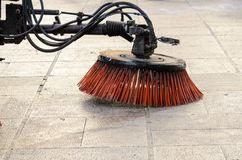 Vehicle sweeping the streets of dirt. Stock Photos