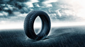 The vehicle tire's under the rain Royalty Free Stock Photo
