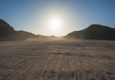 Vehicle tracks through an arid desert Stock Photography