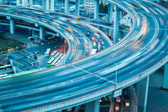 Vehicle trajectory on the bridge approach. Automobile motion blur on the bridge approach royalty free stock image