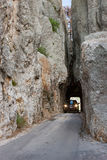 Vehicle Traveling Through Tight Rock Tunnel Royalty Free Stock Images