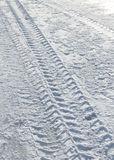 Vehicle tyre tracks on snow Royalty Free Stock Images