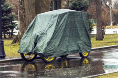 Vehicle under cover Stock Photo
