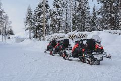 Snowmobile in Lapland - finland royalty free stock photography