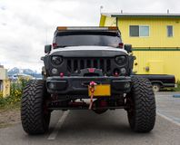 A vehicle used for off-road adventures in the wilds of alaska. A sturdy jeep with heavy-duty springs and over-sized tires as seen parked at seward in the Stock Image