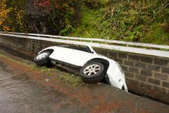 A car in the gutter after a party in the caribbean Stock Photo