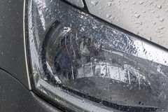 Vehicle Wet Damp Head Lamp Patterns Textures and Reflections Royalty Free Stock Photos