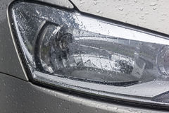 Vehicle Wet Damp Head Lamp Patterns Textures and Reflections Stock Images