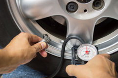 Vehicle wheel add air pressure Royalty Free Stock Image
