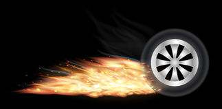 Vehicle wheel with fire burning. A vehicle wheel with fire burning Royalty Free Stock Photo