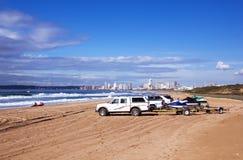 Vehicles on Beach Against City Skyline Durban South Africa Stock Image