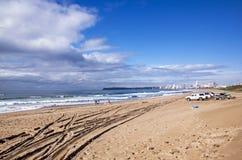 Vehicles on Beach Against City Skyline Durban South Africa stock photography