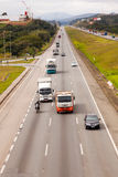 Vehicles on BR-374 highway with headlights on during the daylight obeying the new Brazilian transit laws. SAO PAULO, BRAZIL - JUNE 20, 2016 - Vehicles on BR-374 royalty free stock photography