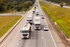 Vehicles on BR-374 highway with headlights on during the daylight obeying the new Brazilian transit laws. SAO PAULO, BRAZIL - JUNE 20, 2016 - Vehicles on BR-374 royalty free stock photos