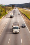 Vehicles on BR-374 highway with headlights on during the daylight obeying the new Brazilian transit laws. SAO PAULO, BRAZIL - JUNE 20, 2016 - Vehicles on BR-374 stock photography