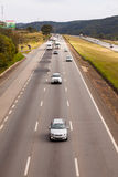 Vehicles on BR-374 highway with headlights on during the daylight obeying the new Brazilian transit laws. SAO PAULO, BRAZIL - JUNE 20, 2016 - Vehicles on BR-374 Stock Photo