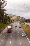 Vehicles on BR-374 highway with headlights on during the daylight obeying the new Brazilian transit laws. SAO PAULO, BRAZIL - JUNE 20, 2016 - Vehicles on BR-374 royalty free stock image