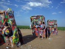 Vehicles buried at Cadillac Ranch. Vehicles buried and painted at Cadillac Ranch in Texas stock images