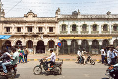 Vehicles on busy Indian street with pedestrians, bikes and cars in Karnataka state Stock Photos