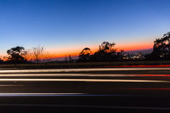 Vehicles Car Lights Speed Blurs Dawn. Travelling traffic motion colors Stock Photo