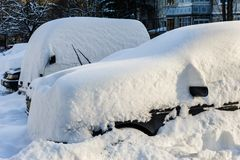 Vehicles covered with snow Stock Image
