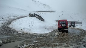 Vehicles driven through risky and dangerous roads of Sikkim after heavy snowfall at Kala Patthar, North Sikkim. Kala Patthar, Lachen, Sikkim, India - 30 April stock images