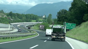 Vehicles driving on a highway. Shot of winding highway with lots of different vehicles driving to certain destination stock video footage