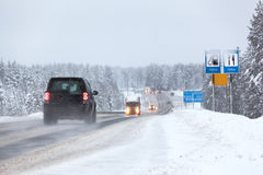 Vehicles driving on the Kola highway in winter season. The Kola is federal road from St. Petersburg to Murmansk Stock Photography