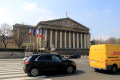 Vehicles driving past front entrance Assemblee Nationale, Paris,France,2016. Busy traffic along main streets, with vehicles passing by front entrance of Royalty Free Stock Image