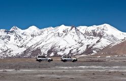 Vehicles goes on the mountain way in Ngari prefecture, Western Tibet. Off-road vehicles goes on the mountain way in Ngari prefecture, Western Tibet, China Stock Images