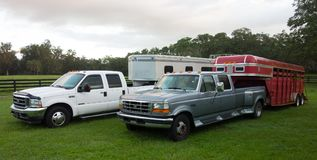 Pick-up trucks with horse trailers parked inside a paddock in florida Royalty Free Stock Photos