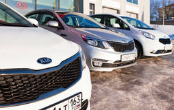 Vehicles KIA near the office of official dealer. SAMARA, RUSSIA - FEBRUARY 13, 2016: Vehicles KIA near the office of official dealer. Kia Motors is South Korea's Stock Photo